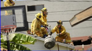 Santa Monica fire fighters remove a steel pipe and concrete that was part of an explosive device detonated in 2011 near Chabad House in Santa Monica. (Photo courtesy Google Images)