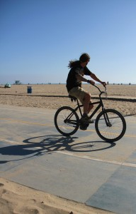 A man rides his bike along the beach bike path on Tuesday. (Daniel Archuleta daniela@smdp.com)