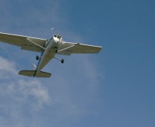 A plane fly's over a neighborhood off of Bundy Drive. (File photo)
