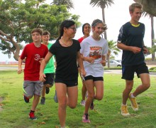 ON THE GO: Justin Sardo (right) leads the Santa Monica Youth Running Club down the median on San Vicente Boulevard. The group also uses Palisades Park for its training classes. (File photo)