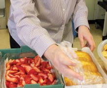 GOOD STUFF: Kathy Osburn prepares meals for seniors at WISE earlier this year. (File photo)