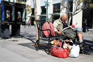 taking a load off: A homeless man rests on the Third Street Promenade, a popular hangout. (File photo)