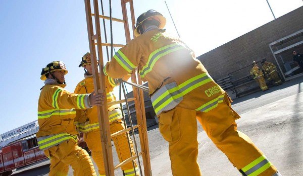GOING UP? A trio of Santa Monica fire fighters hoist a 24-foot ladder during a practice session. (File photo)