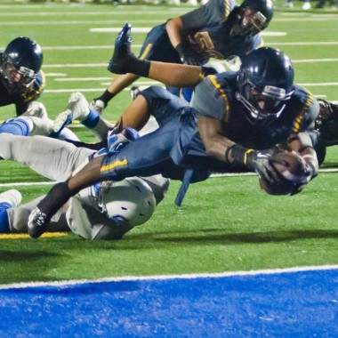 REACHING: Samohi's Kwame Duggins dives in for a touchdown against Culver City last week. (Paul Alvarez Jr. editor@smdp.com)