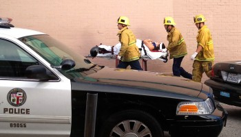 Fire personnel whisk a victim away from the scene of a deadly car crash on the Venice boardwalk. (File photo)