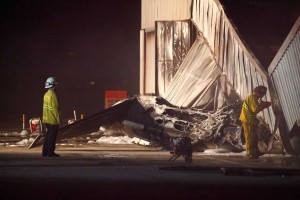 First responders observe the crash site of a small plane at Santa Monica Airport in September. (File photo)