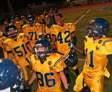 TEAM SPIRIT: Santa Monica High School players surround Matthew Tapia (center) after the Vikings defeated Inglewood, 21-0, at Corsair Field on Friday. Tapia, who has special needs, got into a game for the first time this season as the Vikings ran out the clock. (Morgan Genser editor@smdp.com)
