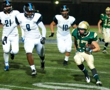 St. Monica's David Araujo runs for a gain against Salesian on Friday. St. Monica lost, 42-3. (Morgan Genser)