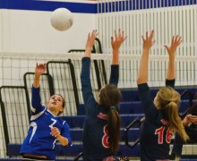 MAKING THE PLAY: Pacifica Christian's Maile Lane spikes the ball past two Brentwood defenders earlier this season. (File photo)