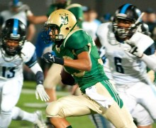 MOVING: St. Monica's Jason Thomas runs as Salesian defenders give chase last week at SMC. (Morgan Genser editor@smdp.com)