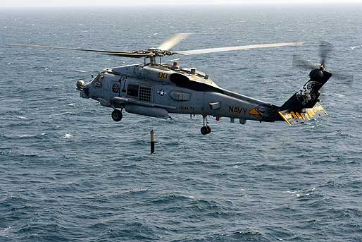 Environmentalists and animal advocates contend that Navy sonar testing in the ocean is harming whales and other marine wildlife and are calling on the Navy to curtail such training and testing exercises accordingly. Pictured: A Navy helicopter lowers a sonar device into the ocean. (Photo courtesy Official U.S. Navy Imagery)