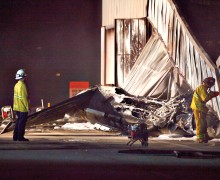 Firefighters survey the crash site at Santa Monica Airport in September. (Photo courtesy David J. Hawkins)