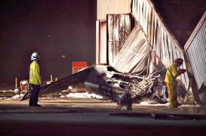 THE SCENE: Firefighters survey the crash site at Santa Monica Airport in September. (Photo courtesy David J. Hawkins)