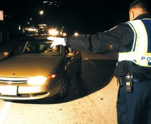 A Santa Monica police officer directs traffic during a DUI checkpoint along Pacific Coast Highway. (File photo)