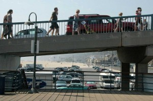 UP THEY GO: Pedestrians walk up the Santa Monica Pier bridge before recent renovations. (File photo)