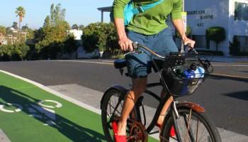 RIDING HIGH: A cyclist travels west on Ocean Park Boulevard's green bike lane on Monday. (Daniel Archuleta daniela@smdp.com)