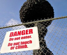A sign instructs the public to avoid the 'Chain Reaction' sculpture. (File photo)