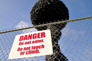 NO GO: A sign instructs the public to avoid the 'Chain Reaction' sculpture. (File photo)