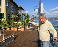 Writer and director Paul Sand shows off the view from the Santa Monica Pier. (David Mark Simpson)