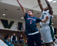 UP IT GOES: Crossroads' Max Pasamonte drives to the basket as Inglewood's Christopher Odionu tries to swat the ball on Wednesday at Santa Monica High. Inglewood went on to win. (Morgan Genser editor@smdp.com)