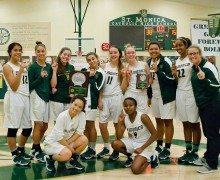 CHEERS: St. Monica's girls' basketball team celebrates after winning their Winter Classic tournament last week. (Paul Alvarez Jr. editor@smdp.com)