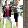 A fitness trainer works with a client in Palisades Park. (File photo)
