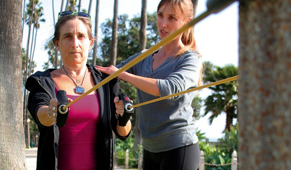 Lisa Foux (Left) works out with trainer Lily Moler (Right) in Palisades Park by the beach. (File photo)