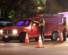 Santa Monica Police officers conduct a DUI checkpoint near Virginia Avenue Park last year. They'll have another one this Friday somewhere in the city. (File photo)