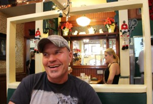 Omelette Parlor owner Bob Hausenbauer, who's owned the restaurant since 1994, smiles while talking with longtime customers Wednesday, the final day of operation for the Main Street breakfast spot.  Hausenbauer said his landlord priced him out. He hopes to relocate soon, but most likely not in Santa Monica. (David Mark Simpson dave@smdp.com)