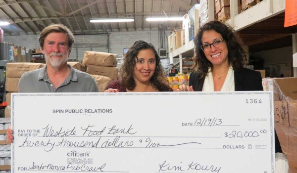 Kim Koury(right), president of Santa Monica-based Spin PR, presents a check for $20,000 to the Westside Food Bank. The money was raised as part of the SANTA Monica Pub Crawl. (Photo courtesy Spin PR)