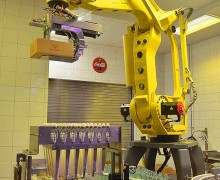 Manufacturing facilities that do not depend on human labor to get work done may have some energy saving benefits but are certainly not beneficial overall considering the impact widespread adoption would have on needed jobs. Pictured: a Robotic arm loading Coca Cola bottles into boxes and loading the boxes onto an assembly line. (Tom Maglieri, courtesy Flickr)
