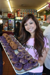 Mayly Tao poses with her latest creation, donuts made with the ube root, a bright lavender yam. (Michael 'Snacks' Ryan michael@smdp.com)