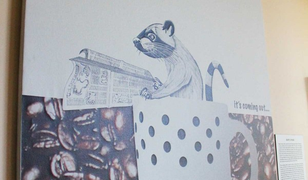Ho had a friend design this poster of a luwak doing his business. (Daniel Archuleta daniela@smdp.com)