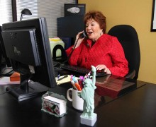 WORKING THE PHONES: CEO Elaine Lazar at the office doing what she does best. (Photo courtesy Eugene Groisman)