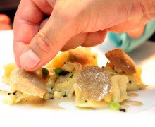 Those seeking fine dining and delicately constructed entrees in Santa Monica might look to Melisse during dineLA's Restaurant Week. Here a chef puts finishing touches on sweet white corn ravioli in a summer truffle sauce. (File photo)