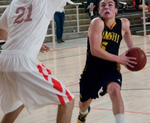 GOING STRONG: Samohi's Ray Mancini tries to drive past Beverly Hills' Ronan Massana (left) on Wednesday. Beverly Hills went on to win the Ocean League game, 55-47. (Morgan Genser editor@smdp.com)