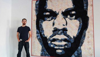 HIP TAKE: Artist Luke Haynes with one of his creations, a quilt featuring the faces of rappers Jay Z and Kanye West. (Brad Farwell www.bradfarwell.com)