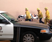 Firefighters assist one of the injured after a crash in Venice Beach in August of last year. (Byron Kennerly)