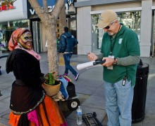 MAKING ROUNDS: Stephen Bradford checks in on one of the street performers he oversees on the Third Street Promenade. (Paul Alvarez Jr. editor@smdp.com)