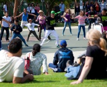 MOVING: Led by Sweat Spot Dance Space instructor Noel Bajanda (center), locals take part in a flash mob during the Santa Monica Festival. (Brandon Wise brandonw@smdp.com)