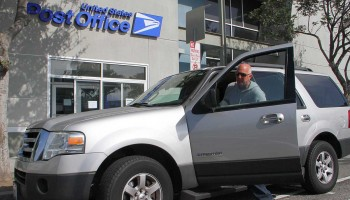 A postal customer boards his truck after dropping off items at the post office on Seventh Street on Monday. (Daniel Archuleta daniela@smdp.com)