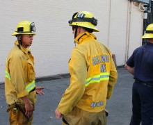TAKING A CLOSER LOOK: Santa Monica fire fighters gather outside of the Gate of India restaurant on Monday afternoon inspecting the damage caused by an early morning fire. (Daniel Archuleta daniela@smdp.com)