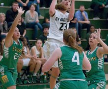 GETTING ONE OFF: St. Monica's Gloria Scipioni (center) goes up for a shot against St. Joseph at home on Wednesday. (Morgan Genser editor@smdp.com)