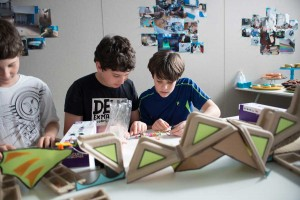 Kids at an open house for Digital Dragon, which provides after-school programs with a tech focus, are hard at work building a circuit board. Digital Dragon's creators, Santa Monica parents Laurie Kantor Finn and her husband, Seth Finn, saw a need for after-school programs that cater to young geeks.  (Photo courtesy Digital Dragon)