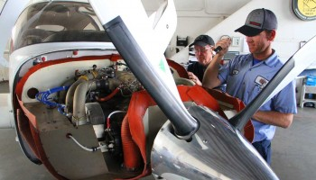 CLOSER LOOK: (L-R) Kim and Brian Davidson inspect a plane at their repair shop at SMO. (Daniel Archuleta daniela@smdp.com)