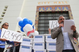 Armen Melkonians, founder of the Residocracy movement, speaks to a crowd of supporters gathered outside of City Hall on Tuesday. The group was there to drop off signatures calling for a referendum against a City Council-approved development. (Daniel Archuleta daniela@smdp.com)