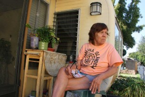 Village Trailer Park resident Frances Ward, 76, sits on the porch of her home. She has plans to move. (Daniel Archuleta daniela@smdp.com)