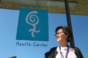 THE SPOT: Celia Bernstein, director of development at the Westside Family Health Center, stands in front of the clinic. (Daniel Archuleta daniela@smdp.com)