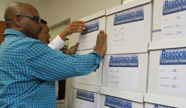 LOTS: The city clerk's staff stacks boxes full of referendum petitions at City Hall on Tuesday. (Daniel Archuleta daniela@smdp.com)