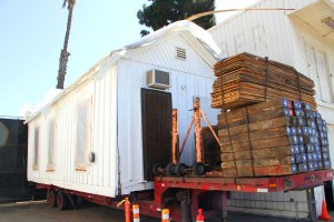 TIME FOR A RIDE: The historic Shotgun House is ready to roll to its new home. (Daniel Archuleta daniela@smdp.com)